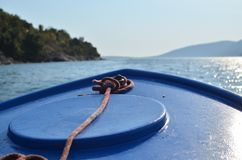 Bow of a moving boat. Bow of a blue boat sailing on a sea surface Royalty Free Stock Image