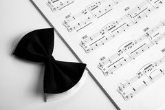 Bow near the musical book. Clos-up Royalty Free Stock Photos