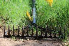 Bow Rake. Close up view of someone using a bow rake Royalty Free Stock Photos