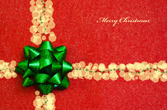Bow on the red background - holiday concept Royalty Free Stock Photo