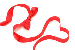 Bow from a red satiny tape Stock Photography