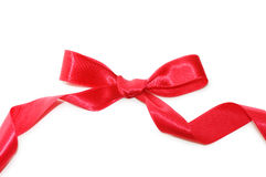 Bow from a red satiny tape Stock Photos