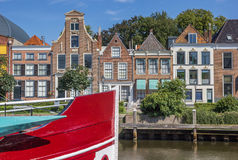 Bow of a red ship and historical houses in Zwolle Royalty Free Stock Images
