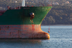 Bow with red waterline of big industrial cargo ship Stock Image