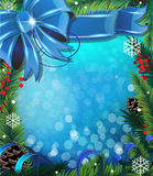Bow, ribbon and fir tree branches. On blue Christmas background Royalty Free Stock Photos