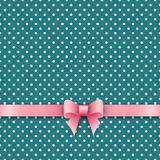 Bow and ribbon on green polka dot background Royalty Free Stock Image