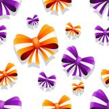 Bow and ribbon seamless pattern in orange and purple colors. Vector illustration. Ideal for wallpaper, wrapping, packaging and any kind of decoration Stock Image