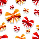 Bow and ribbon seamless pattern in red and orange colors. Vector illustration. Ideal for wallpaper, wrapping, packaging and any kind of decoration Stock Photos