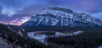Bow River meandering below the Rundle Mountain Stock Image