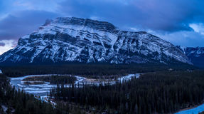 Bow River meandering below the Rundle Mountain Stock Photo