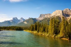 Bow River near Canmore in Canada. Bow River in Banff National Park near Canmore with Canadian Rocky Mountains in the background, Alberta, Canada Royalty Free Stock Photos