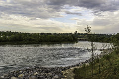 Bow River view. Bow river seen by Calgary banks royalty free stock photo