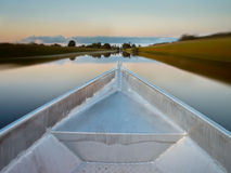 Bow of a Rowing Boat in a Swamp. Bow of a Rowing Boat in the Evening with Blurred Background Because of the Movement Stock Photo