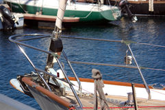 Bow of a sailboat moored to port Royalty Free Stock Image