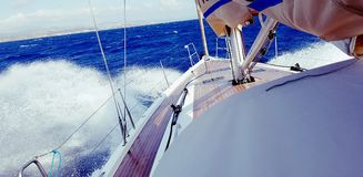 Bow of sailboat in waves Royalty Free Stock Image