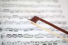 Bow and sheet music Stock Photos