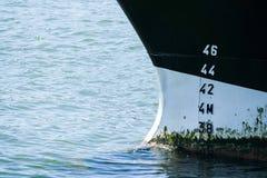 Bow of a ship anchoring Stock Photos