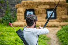 Bow shooting outside Royalty Free Stock Image