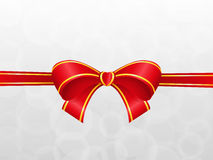 Bow on the silver. Background Royalty Free Stock Photo