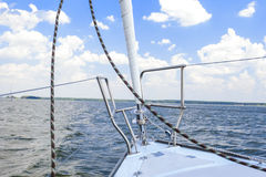 Bow of the Small Yacht Under Sailing On Open Waters. royalty free stock image