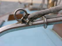 Bow snapshackle on a yacht. Stainless steel snapshackle used on a yacht Stock Images