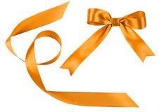 Bow and tape from golden satin fabric Stock Photo