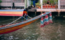 Bow of Thai long tail boat with garlands in Banhkok canal Klong. Bow of Thai long tail boat with garlands in Banhkok`s canal Klong, famous river transportation stock photo