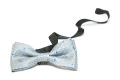 Bow tie. Grey children's bow tie with blue spots; on white background Stock Images