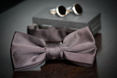 Bow tie. Groom accesories. Bow tie and cufflinks Royalty Free Stock Photo