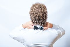 Bow tie on the back side. Strange or fun concept. Stock Images