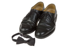Bow-tie and black shoes royalty free stock images