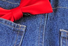 Bow tie and blue jeans Royalty Free Stock Image