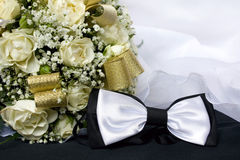 Bow Tie and Bouquet. Bow tie and bride's bouquet Royalty Free Stock Image