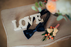 Bow tie and boutonniere. On a wooden table Stock Images