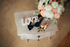 Bow tie and boutonniere. On a wooden table Royalty Free Stock Photos
