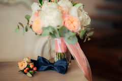 Bow tie and boutonniere. On a wooden table Stock Photo