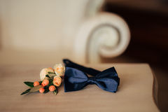 Bow tie and boutonniere. On a wooden table Royalty Free Stock Images
