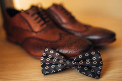 Bow tie and brown shoes Stock Photos
