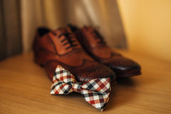 Bow tie and brown shoes Royalty Free Stock Image