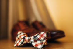 Bow tie and brown shoes Stock Images