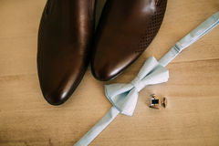 Bow tie and brown shoes Royalty Free Stock Photo