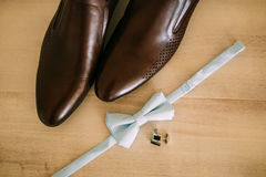 Bow tie and brown shoes Stock Photo