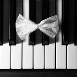 Bow tie -butterfly on piano Royalty Free Stock Image
