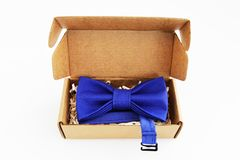 Bow tie in a cardboard gift box. Color blue