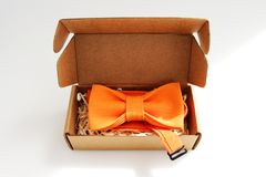 Bow tie in a cardboard gift box. color orange