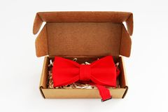 Bow tie in a cardboard gift box. Color red