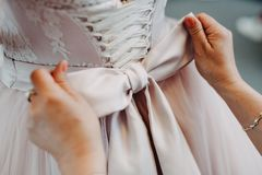 Bow tie on elegant wedding dress stock photo