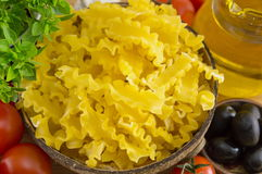Bow tie farfalle pasta in a bowl with vegetables Stock Photos