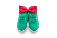 Bow tie and  green sneakers isolated on white Royalty Free Stock Images