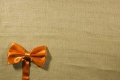 Bow tie on a linen napkin Stock Photos